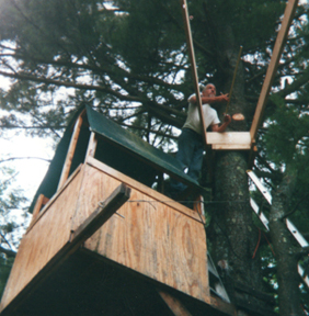 constructing 2nd story of treehouse